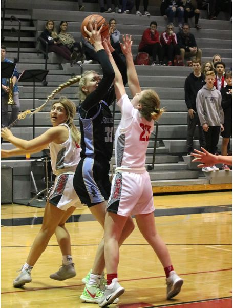 PMG PHOTO: JIM BESEDA - Mountainside's Cameron Brink shoots over Oregon City's Mia Martineau (23) during Friday's first half.