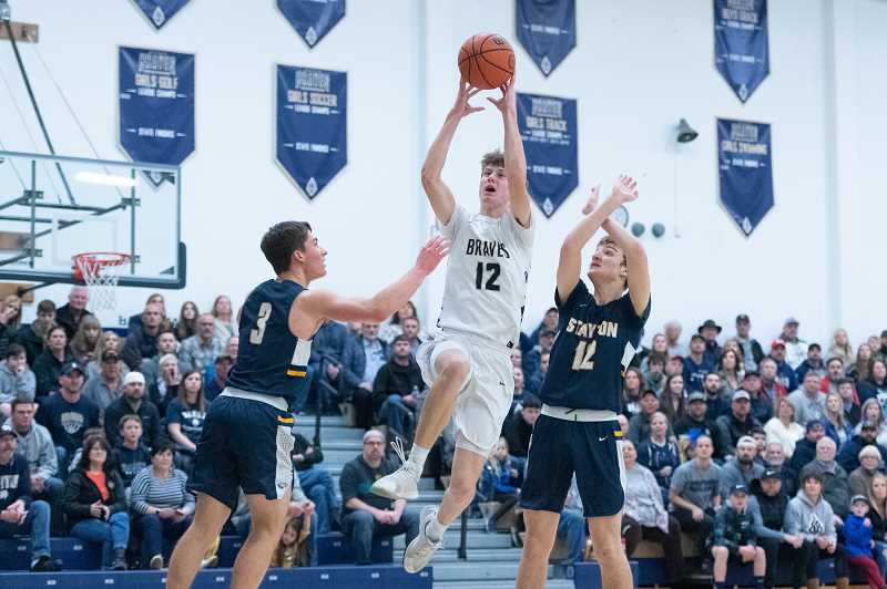 PMG PHOTO: CHRISTOPHER OERTELL - Banks' Jacob Slifka (12) during an OSAA 4A boys basketball playoff game against Stayton at Banks High School in Banks, Ore., on Saturday, March 7, 2020.