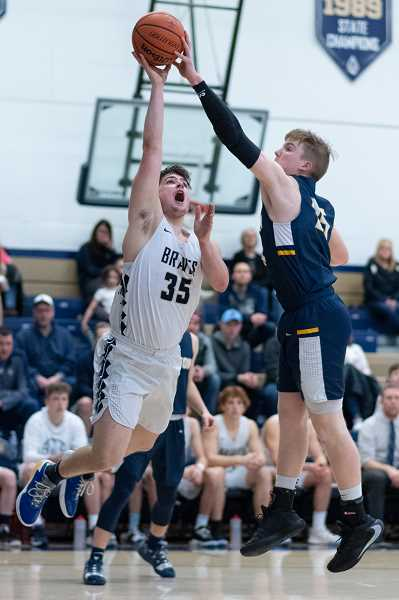 PMG PHOTO: CHRISTOPHER OERTELL - Banks' Tyler Exline (35) during an OSAA 4A boys basketball playoff game against Stayton at Banks High School in Banks, Ore., on Saturday, March 7, 2020.