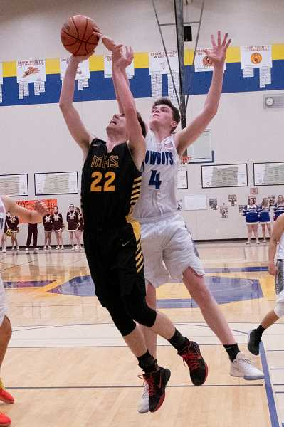 LILAH JOHNSON FOR THE CENTRAL OREGONIAN - Mason Plumb goes up for two of his 14 points for Milwaukie Saturday night as the Mustangs lost to the Crook County Cowboys.