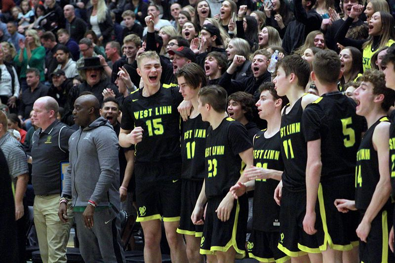 PMG PHOTO: MILES VANCE - West Linn's Joe Juhala (center, no. 15) leads his team in cheers at the end of its 68-50 win over Mountainside in the second round of the Class 6A state playoffs at Mountainside High School on Saturday, March 7.