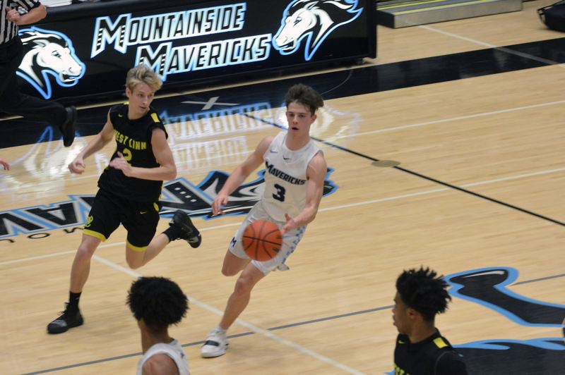 TIMES PHOTO: MATT SINGLEDECKER - Mountainside junior point guard Sammy Cohen was a spark in the second half against West Linn.