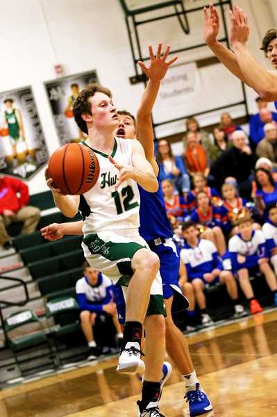 COURTESY PHOTO: JO WHEAT - North Marion senior Brady Hansen added 17 points in the victory, including 9-of-12 free throws. The Huskies were 32-of-49 from the charity stripe in the win.