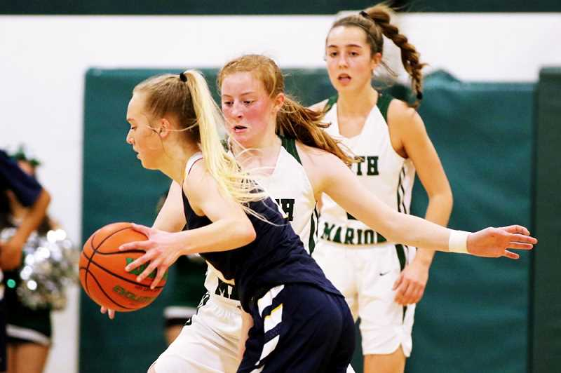 COURTESY PHOTO: JO WHEAT - North Marion junior Dani Christenson defends Stayton senior K.J. Nyquist in the Huskies 37-34 win over the Eagles. Christenson teamed with sophomore Jaydan Sahlin (background) to limit Nyquist — Staytons leading scorer — to just 11 points in the victory.
