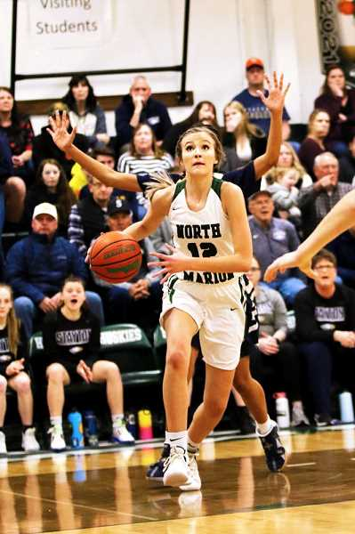 COURTESY PHOTO: JO WHEAT - North Marion senior Katie Ensign led the Huskies with 17 points and will make her fourth consecutive appearance in the 4A State Quarterfinal tournament in Forest Grove.