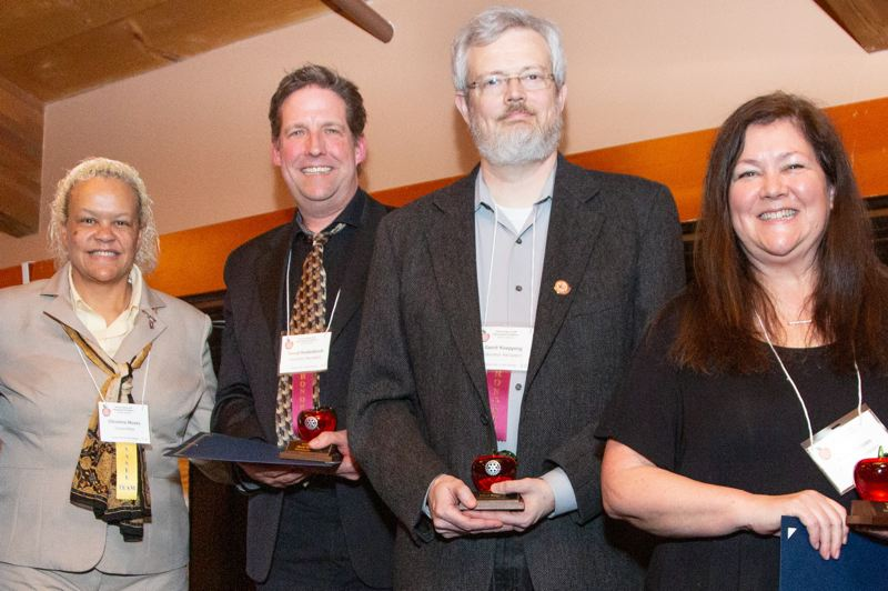 From left to right, presenter Christine Moses and educator recipients David Rodenkirch, Gerrit Koepping and Kasie Hansen.