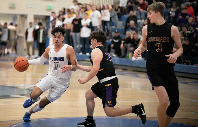 COURTESY PHOTO: RICK VASQUEZ - Woodburn junior Jeovanny Marroquin led the Bulldogs with 23 points in the team's 67-63 overtime victory over the Marshfield Pirates on Friday.
