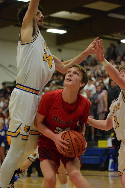 PMG PHOTO: DAVID BALL - Westviews Brady Grier puts on a pump fake on the block to get Barlow defender Joey Wolcott into the air.