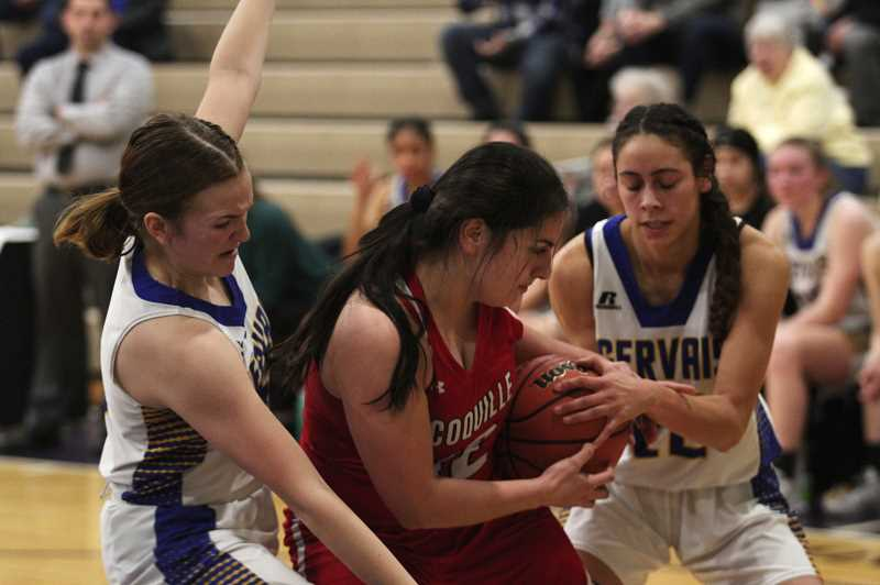 PMG PHOTO: PHIL HAWKINS - Gervais senior Isabel Vasquez (right) and freshman Izzy Boyd harry Coquille post Mia Ruiz in the Cougars 56-48 loss to the Red Devils in the consolation round of the 2A State Quarterfinal tournament.