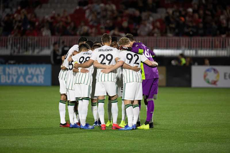 COURTESY PHOTO - Members of the Timbers 2 huddle during last weekend's season opener at Phoenix Rising FC, March 7, in Scottsdale, Arizona.