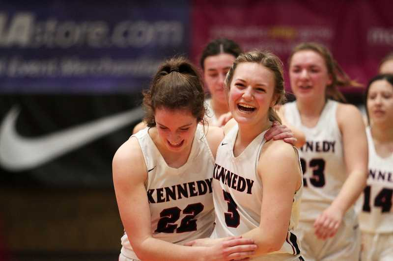 PMG PHOTO: PHIL HAWKINS - JFK juniors Ellie Cantu and Elise Suing embrace following team handshakes. The pair, along with fellow junior Hailey Arritola, were freshmen on Kennedy's 2018 title team and were eager to make bring home a championship of their own the second time around.