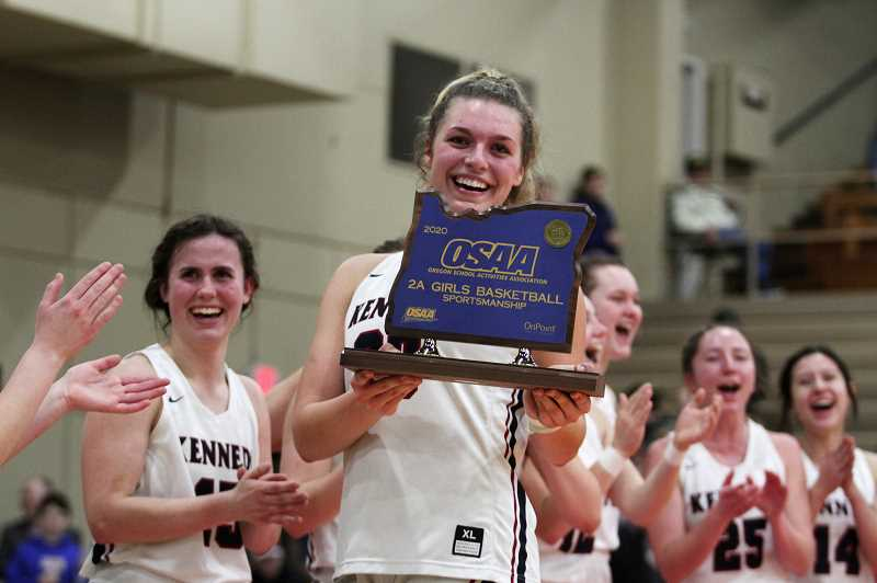 PMG PHOTO: PHIL HAWKINS - In addition to winning the state title, the Trojans were also awarded with the team sportsmanship trophy — held by senior Sophia Carley, who was a unanimous selection to the All-Tournament First Team.
