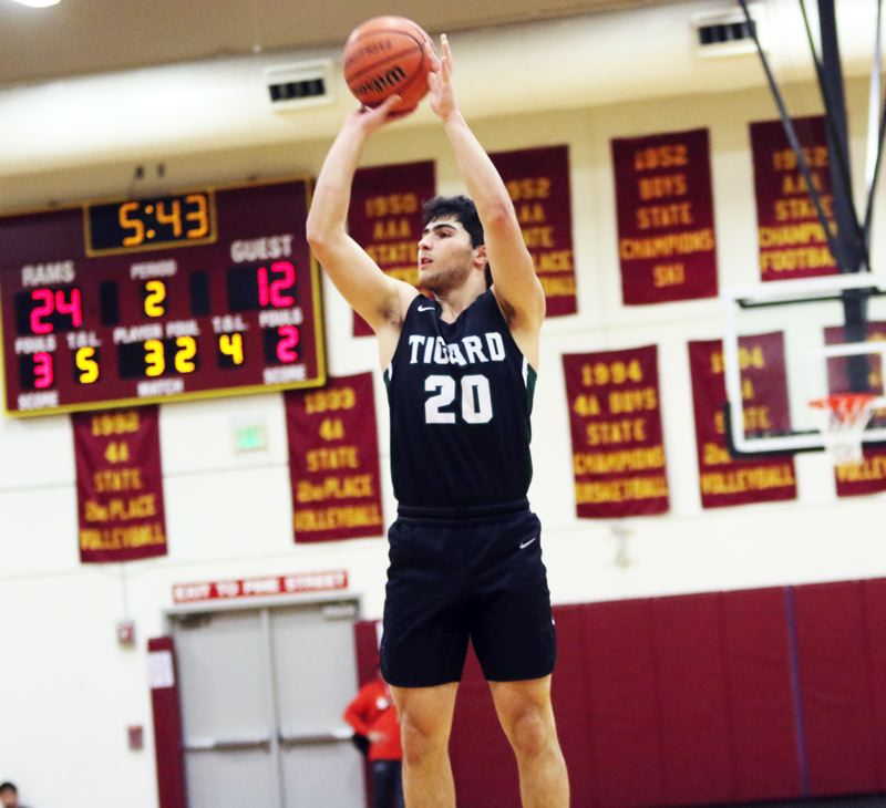 PMG PHOTO: DAN BROOD - Tigard High School junior Edward Beglaryan goes up for a jump shot during the Tigers' Class 6A state playoff game at Central Catholic on Saturday.
