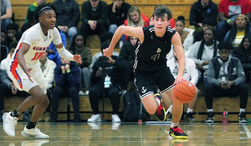 PMG PHOTO: MILES VANCE - Lake Oswego senior guard Jack Chlumak has been a key addition for the Lakers this year as they played their way back to the Class 6A state tournament.