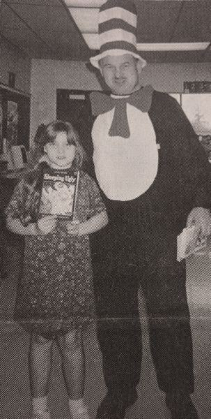 ARCHIVE PHOTO - In 1990, River Mill Elementary School student Cassie Copeland posed for a photo with the Cat in the Hat, otherwise known as school Principal Larry Adamson.