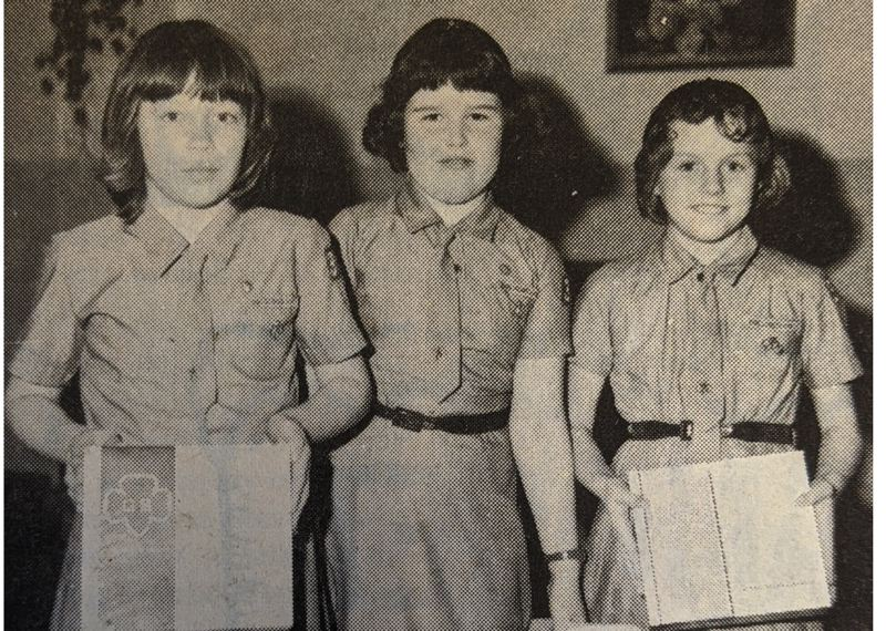 PMG FILE PHOTO - For years spring has been known to many as not only a time to clean, but a time to stock up on Girl Scout cookies. This time 50 years ago, Sandys Brownie Scouts Jean Michael, Cindy Kenley and Julie Predmore (pictured) were eager to start selling.
