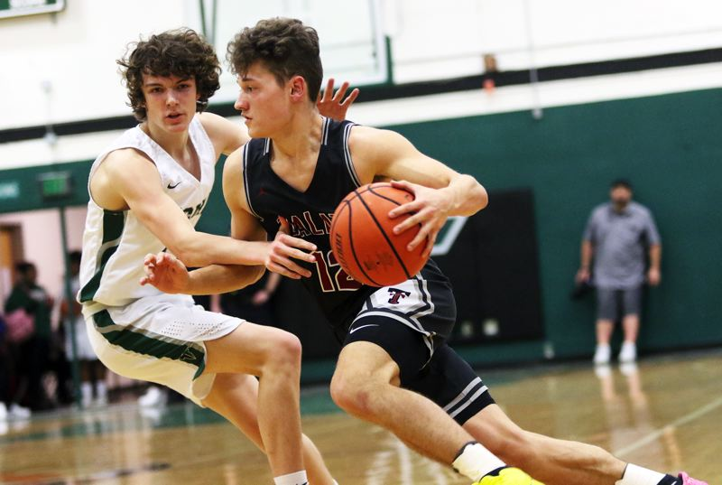 PMG PHOTO: DAN BROOD - Tualatin High School senior Sam Noland (right), shown here in a game earlier this season, had a strong overall perforamance, with 10 points, eight rebounds and four assists, in the state playoff game at Mountainside.