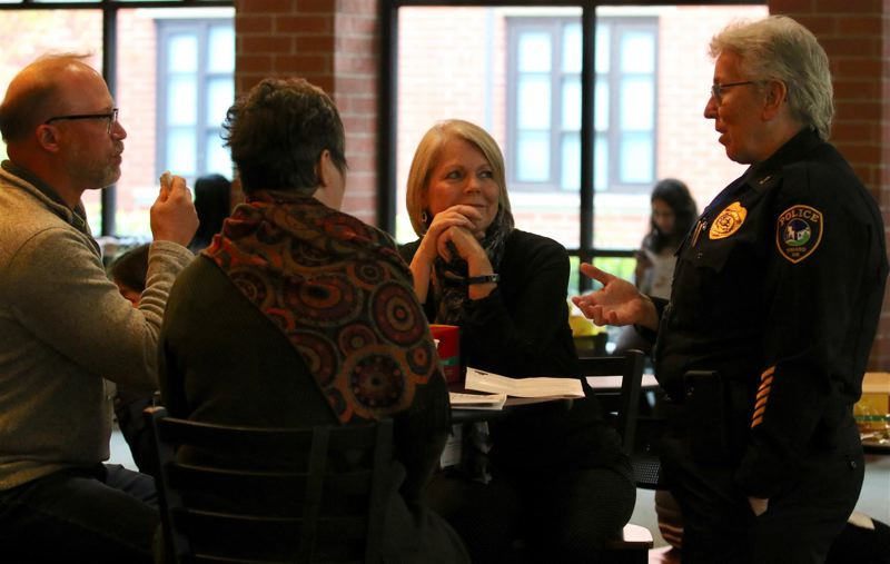 PMG PHOTO: J. BRIAN MONIHAN - Tigard Police Chief Kathy McAlpine, right, and other attendees talk during last year's Multi-City Equity Summit.
