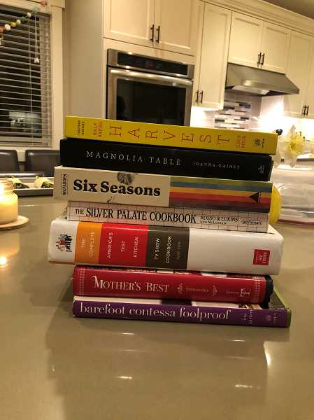 Each year the women select a cookbook to use as the resource for all the feasts they create. This is the lineup of books they have used throughout their history. At top is this years selection, Half Baked Harvest.