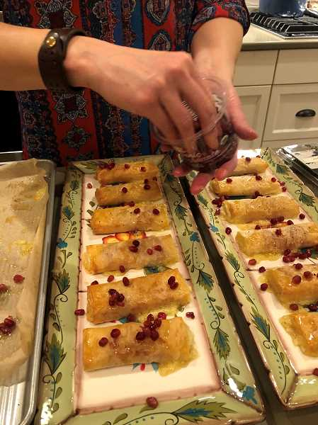 Rebecca Demorests appetizer was brie and proscuitto baked in phyllo then drizzled with honey and sprinkled with festive pomegranate arils. All the recipes came from Half Baked Harvest, their selected cookbook for the year.