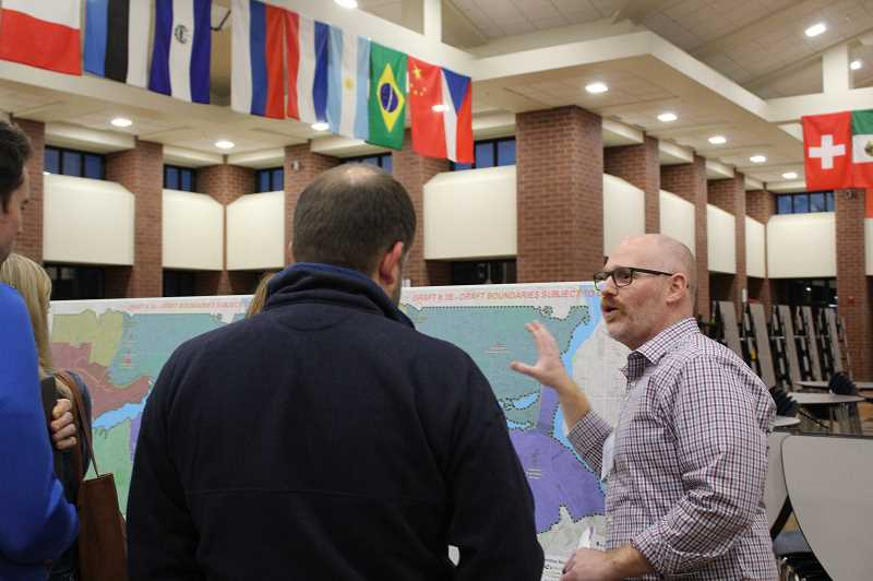 PMG PHOTO: ASIA ALVAREZ ZELLER - Lake Grove Principal Scott Schinderle talks to parents at the Boundary Review Open House.