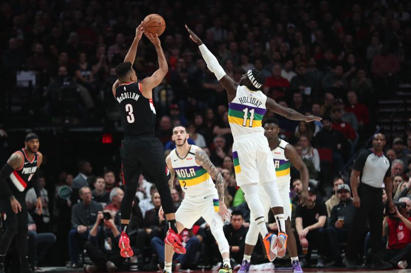 PMG FILE PHOTO - Portland Trail Blazers guard CJ McCollum shoots during a February game at the Moda Center. The NBA has suspended its season because of concerns about the coronavirus.