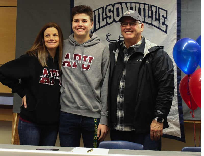 COURTESY PHOTO - Wilsonville senior Ethan Campbell, standing with his parents, recently signed to play football at Azusa Pacific.