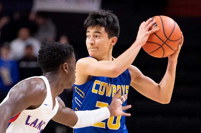 LON AUSTIN/CENTRAL OREGONIAN - Jesse Sanchez looks for someone to pass to during the first half of Crook County's 70-47 loss to the Churchill Lancers Wednesday afternoon during the OSAA Class 5A State BAsketball playoffs. Sanchez scored nine points in the game.