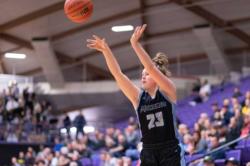 PMG PHOTO: CHRISTOPHER OERTELL - Mountainside's Carly Stone shoots a three-pointer during the quarterfinals of the OSAA 6A state girls basketball championship at the Chiles Center on the campus of the University of Portland on Wednesday, March 11, 2020.