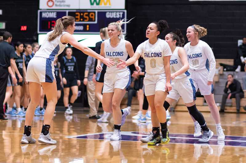 PMG PHOTO: CHRISTOPHER OERTELL - Liberty players celebrate during a timeout at the quarterfinals of the OSAA 6A state girls basketball championship at the Chiles Center on the campus of the University of Portland on Wednesday, March 11, 2020.