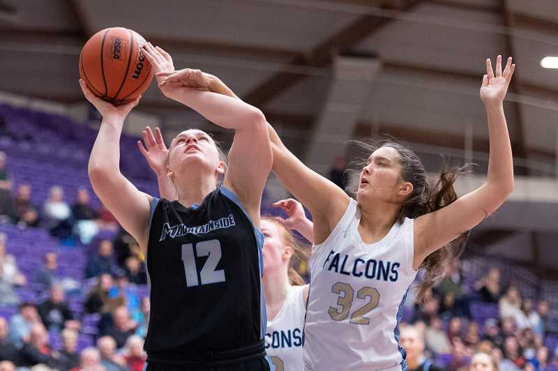 PMG PHOTO: CHRISTOPHER OERTELL - Mountainside's Lindsey Wilson (12) and Liberty's Alyssa Chronister (32) during the quarterfinals of the OSAA 6A state girls basketball championship at the Chiles Center on the campus of the University of Portland on Wednesday, March 11, 2020.