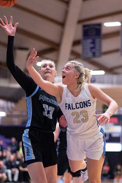 PMG PHOTO: CHRISTOPHER OERTELL - Mountainside's Cameron Brink (33) and Liberty's Bella Hamel (23) during the quarterfinals of the OSAA 6A state girls basketball championship at the Chiles Center on the campus of the University of Portland on Wednesday, March 11, 2020.