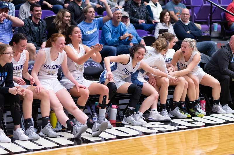 PMG PHOTO: CHRISTOPHER OERTELL - The Liberty bench celebrates late in the fourth quarter during the quarterfinals of the OSAA 6A state girls basketball championship at the Chiles Center on the campus of the University of Portland on Wednesday, March 11, 2020.