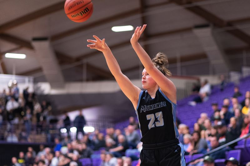 TIMES PHOTO: CHRIS OERTELL - Mountainside's Carly Stone (23) during the quarterfinals of the OSAA 6A state girls basketball championship at the Chiles Center on the campus of the University of Portland in Portland, Ore., on Wednesday, March 11, 2020.