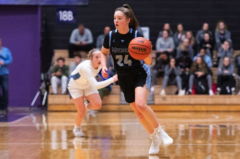 TIMES PHOTO: CHRIS OERTELL - Mountainside's Halle Hageman (24) during the quarterfinals of the OSAA 6A state girls basketball championship at the Chiles Center on the campus of the University of Portland in Portland, Ore., on Wednesday, March 11, 2020
