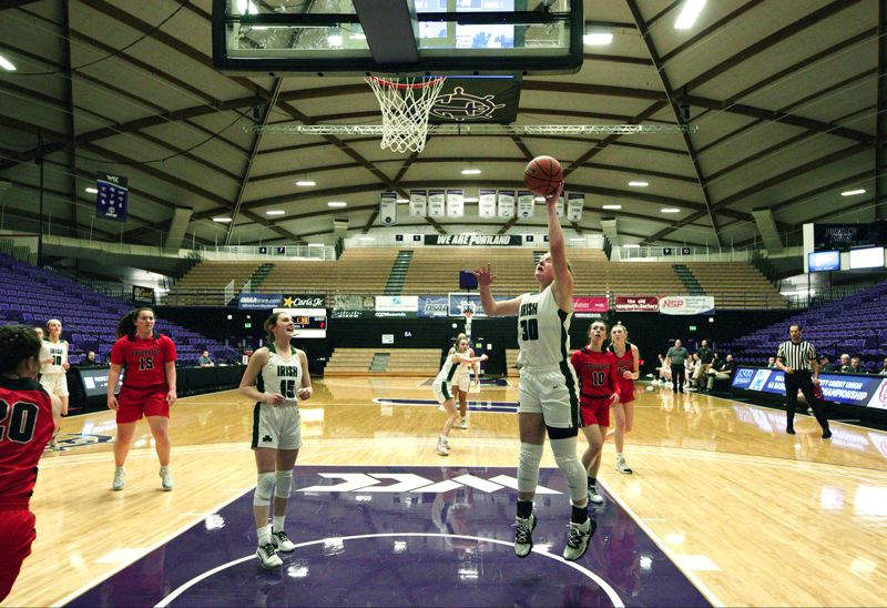 PMG PHOTO: JAIME VALDEZ - Sheldon freshman Beaux Bruegman goes up for a shot during her team's 51-20 win over McMinnville in the consolation semifinals of the Class 6A girls basketball state tournament at the Chiles Center on the University of Portland campus.