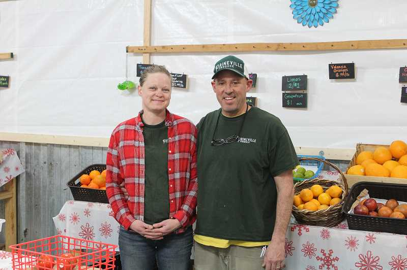 DESIREE BERGSTROM - Becky and Patrick Clark display some of their fruits and vegetables that they provide at Prineville Produce.