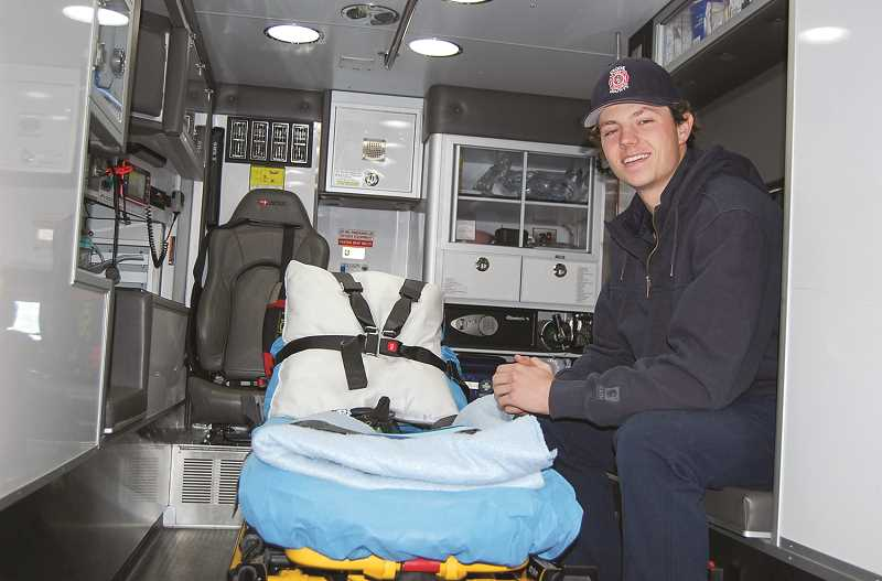 RAMONA MCCALLISTER - Ethan Cossitt sits in the back of a CCFR ambulance, and he often helps to redress the stretchers and wipe down an ambulance after a call.
