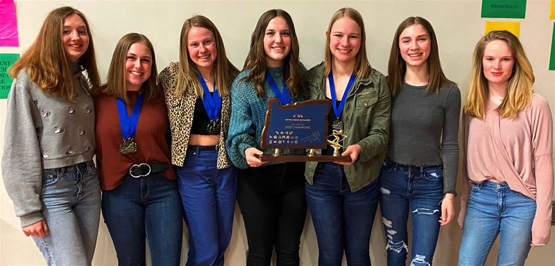 COURTESY PHOTO - Members of the Tigard High School girls ski team gather with the Metro League champioship trophy. Pictured (from left) are Guilia Cortelazzo, Corin Hartnell, Sarah Gentry, Megan Wargo, Emily Sverdrup, Kaiya Welch and Lily McNutt. Not pictured, Haley Cabrera, Clarice Paz, Tessa Carstens, Samantha Rumford and Elena Hartnell.