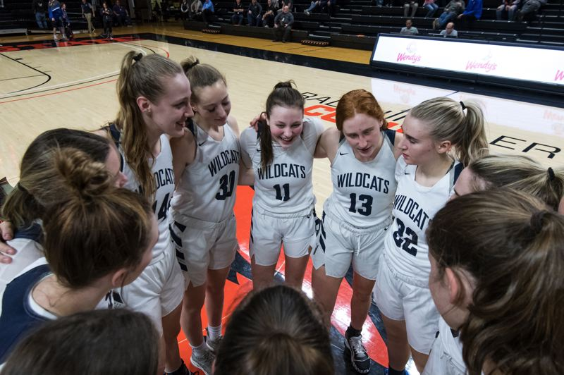 COURTESY PHOTO: GREG ARTMAN - Wilsonville's girls basketball team huddles before Tuesday's state quarterfinal game.