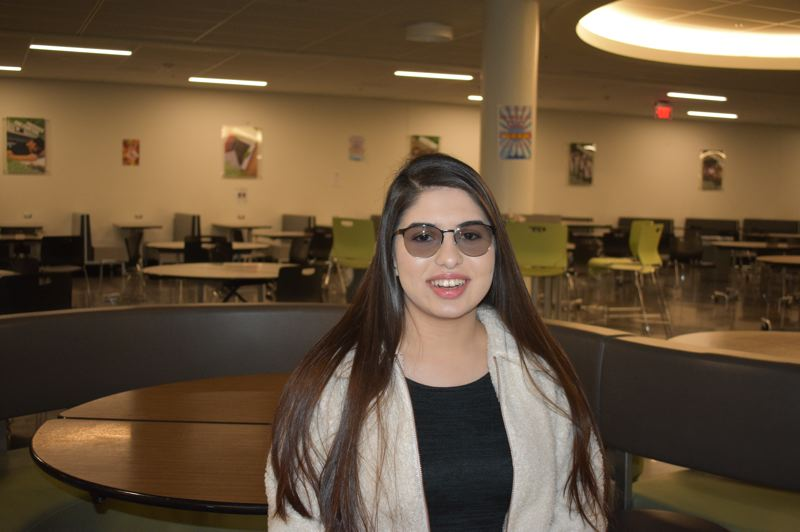 PMG PHOTO: TERESA CARSON - Christina Saada, an honor roll student at Reynolds High School, just won a big scholarship and plans to become a doctor.