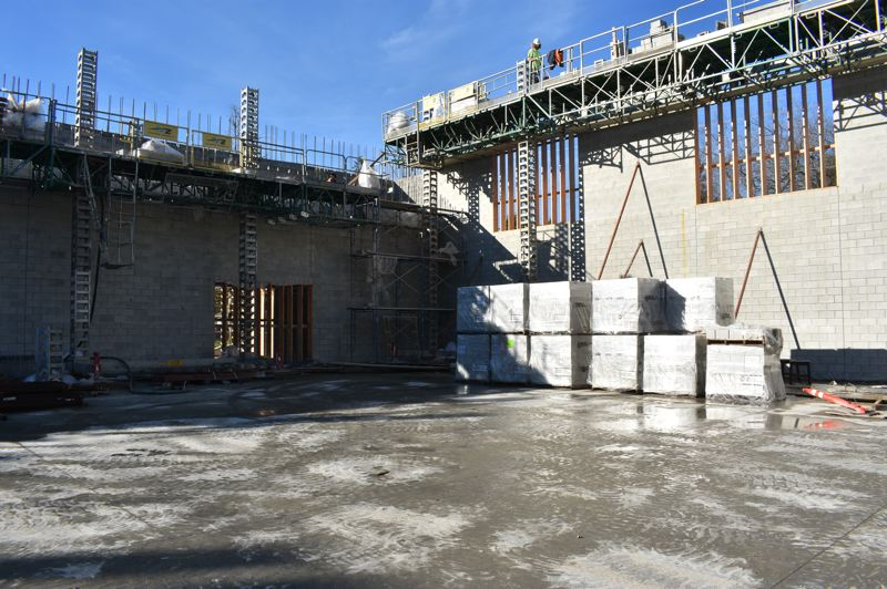 PMG PHOTO: TERESA CARSON - The gym walls are still going up. It wont be open to students until February.