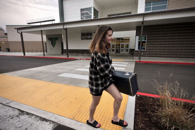PMG PHOTO: JAIME VALDEZ - Tigard High School freshman Kyra Davala arrived Friday morning to take home her saxophone. She says she needs to practice her instrument. Tigard-Tualatin School District was among the first in Oregon to announce public school closures in the wake of the COVID-19 outbreak.