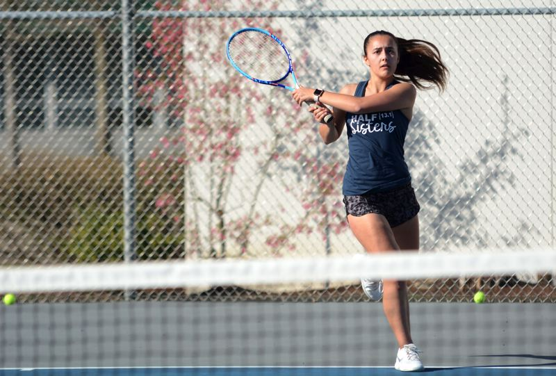 PMG PHOTO: DEREK WILEY - Rachel Bigej hits a backhand during Canby's tennis practice last week.