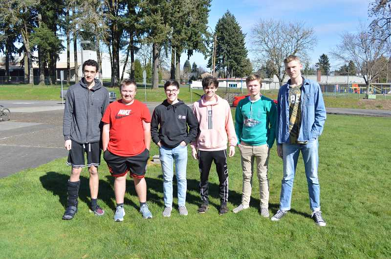 PMG PHOTO: DARRYL SWAN - The Scappoose boys golf team