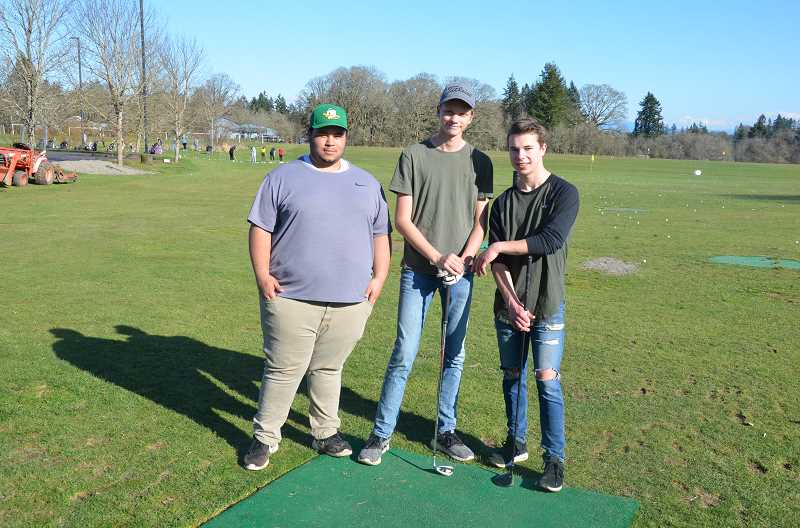 PHOTOS BY JOHN BREWINGTON - Three of St. Helens golf team's returning golfers, making up the core of the team, are ready for the season to start.
