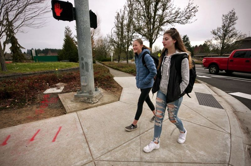 PMG PHOTO: JAIME VALDEZ - Talia Valdez, left, and Madelyn Poling, both eighth graders at Inza R. Wood Middle School in Wilsonville, walk to school Friday morning.