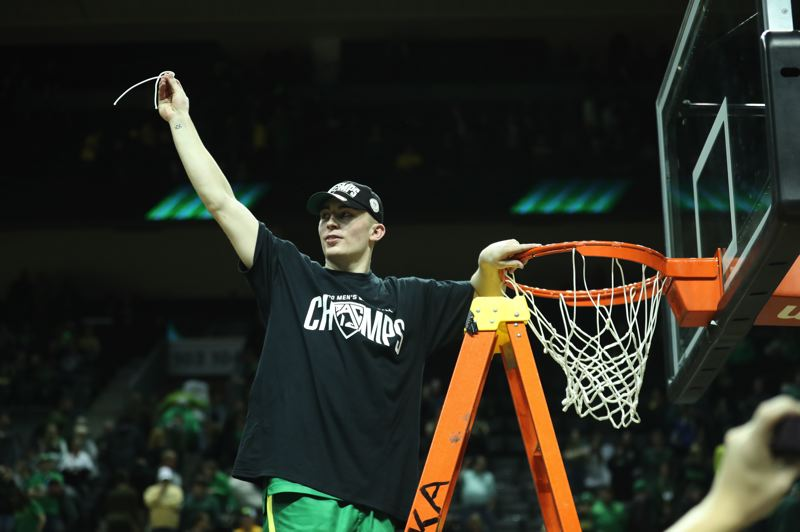 PMG PHOTO: JAIME VALDEZ - Senior Payton Pritchard got to cut down the net as Oregon won the 2020 Pac-12 regular-season title.