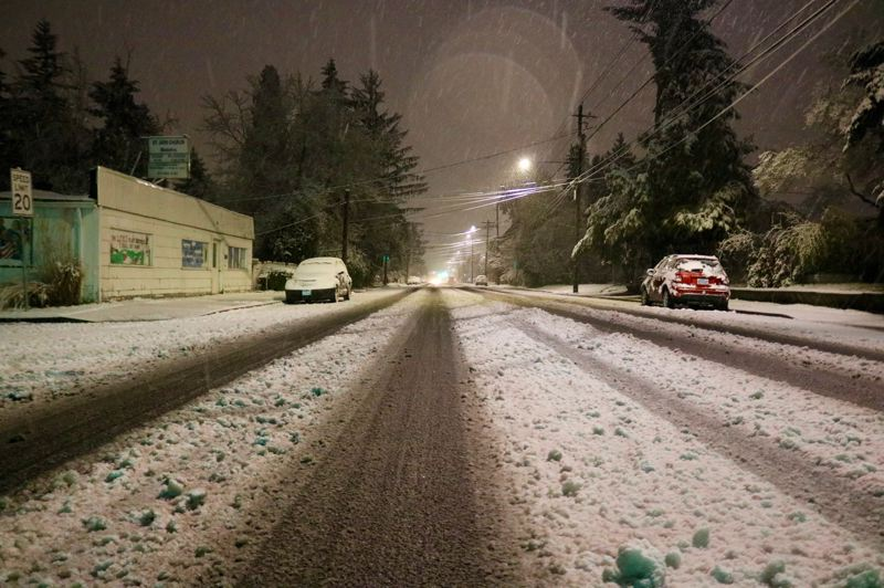 PMG PHOTO: ZANE SPARLING - Northeast Portland woke up to a helping of the white stuff, with flakes continuing to fall before 7 a.m. on Saturday, March 14.
