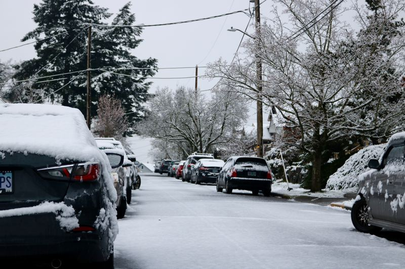 PMG PHOTO: ZANE SPARLING - Cars were dusted in snow during the morning of Saturday, March 14 in Northeast Portland.